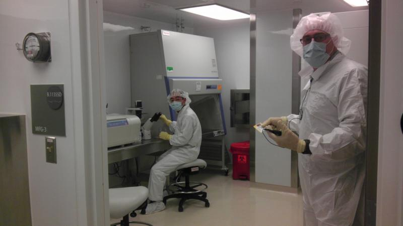 Researchers suit up to work at the new facility