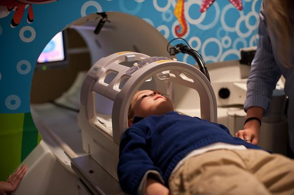 4-year-old Mason Ray gets acclimatized to an MRI machine before having a brain scan