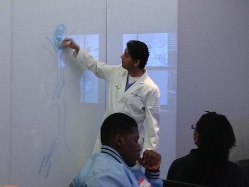 Adnan Siddiqui teaches students at the Gates Vascular Institute in Buffalo.