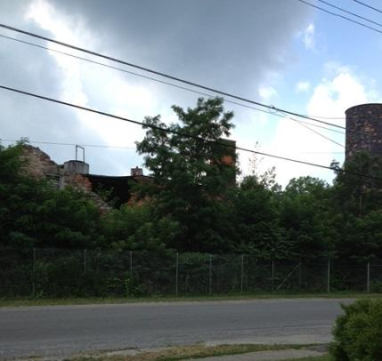 The former Flintkote building is one of the industrial sites that lead to the creek's contamination.