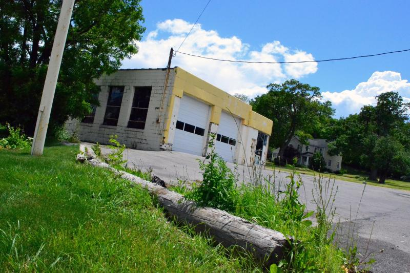 Vacant properties, like this former gas station in Syracuse, dot rustbelt cities.