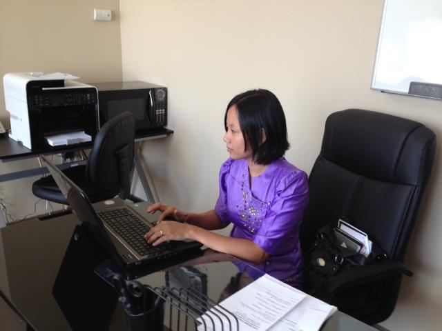 Chan Thu working at her desk.