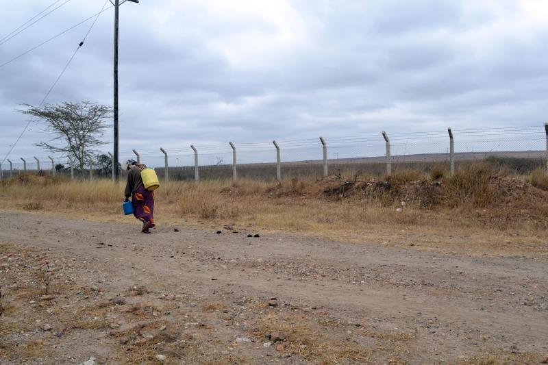 A woman walks by the site of the proposed Konza Techno City about 50 miles outside of Nairobi.