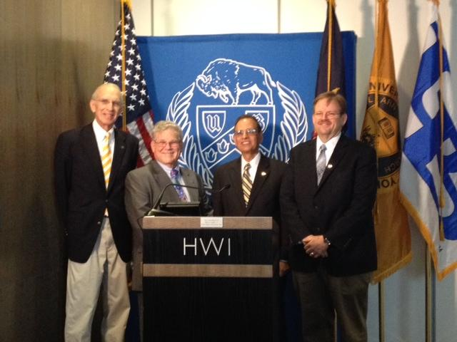 CEO of HWI Eaton Lattman, UB President Satish Tripathi, Vice President of Research and Economic Development at HWI Alexander Cartwright.