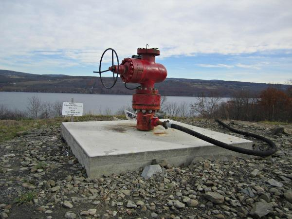 Red metal device used to monitor pressure and realease natural gas below ground