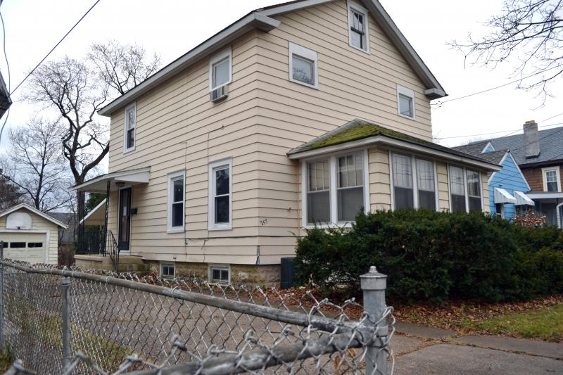 This house on South Collingwood Ave. in Syracuse is the first the city's new land bank sold.