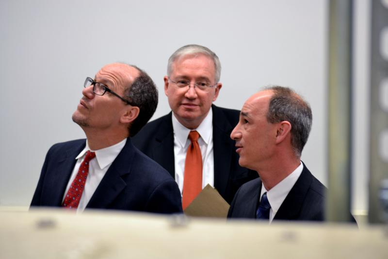 U.S. Labor Secretary Thomas Perez, left, tours the Syracuse Center of Excellence with CoE director Ed Bogucz and NuClimate's John DiMillo.