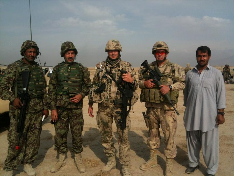 Aziz (right) with German, Canadian and Afghan military personnel in Kabul, Afghanistan in 2012