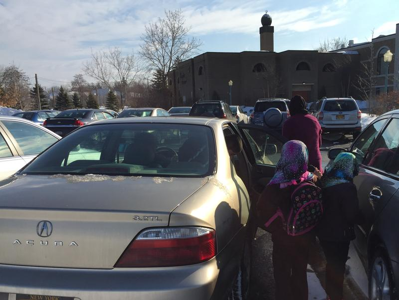 Aziz's wife Khaledah takes his children into Sunday school at the Islamic Center of Rochester