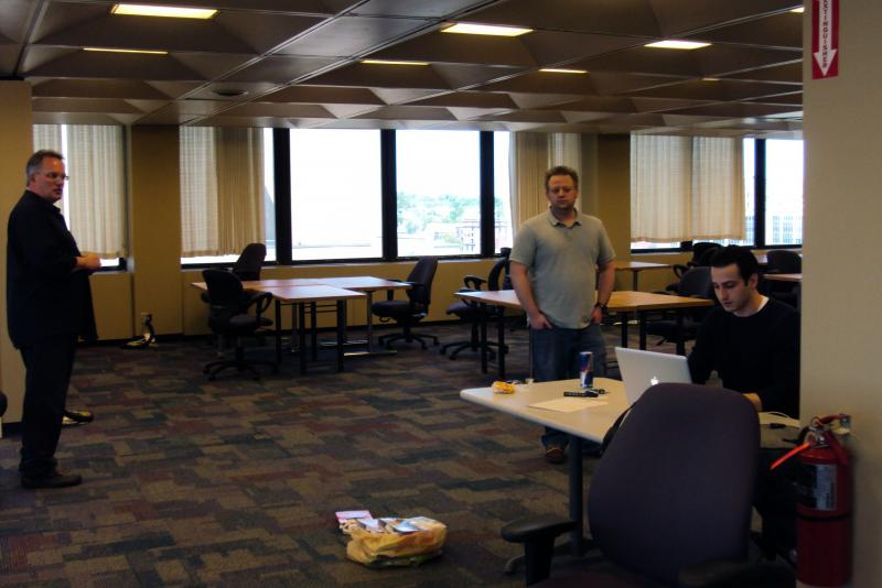 Chuck Stormon, left, checks on last-minute preperations before the StartFast Venture Accelerator starts Monday in Syracuse.