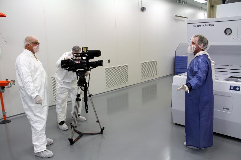 Natcore's Rich Topel discusses the new clean room with a local TV crew.