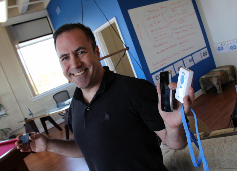 """Sam Weiner, President and CEO of Quantum Loop Solutions. He's holding his company's """"one stop shop"""" mobile payments platform."""