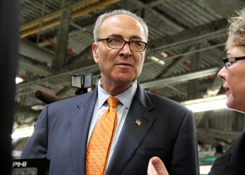 Sen. Chuck Schumer speaking with Delphi's Mary Gustanski at Monday's event. Schumer is fighting a proposed funding cut that would slow a Delphi fuel cell program.
