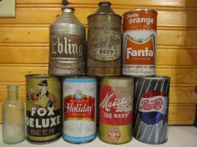 Some of the beer cans found when Lake Delhi emptied. They can fetch up to $50.