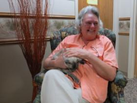 Lisa Davis with the resident cat at Trinity Center.