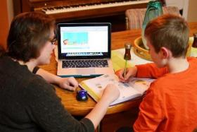 Christine Larson and her son, Isaac, are part of an online education experiment in Iowa called the Virtual Academy