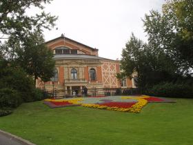 """The Bayreuth Festival House, built by Wagner for performing his Ring Cycle and funded largely by his patron Ludwig II of Bavaria (popularly known as """"Mad King Ludwig"""" )."""