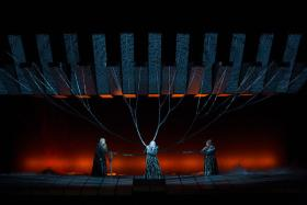 "A scene in Wagner's ""Götterdämmerung"" with the Norns (Michaela Martens, Elizabeth DeShong, Heidi Melton), from the Metropolitan Opera's current production."