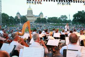 Maestro Joseph Giunta directs the Des Moines Symphony Orchestra at the Yankee Doodle Pops concert.