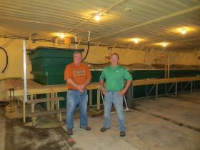 Jeff (left) and Mark Nelson are partners in the aquaculture business. They've converted a hog barn into a facility filled with fish tanks.