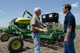 Rick and Grant Kimberley plant soybeans on their farm near Maxwell