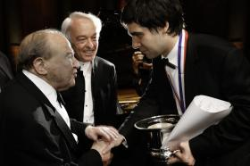 Yadym Kholodenko, right, 26, of Ukraine, is congratulated by jury members Menahem Pressler, left, and Andrea Bonatta, center, after winning the Gold Medal in the 14th Van Cliburn International Piano Competition Sunday.