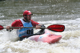 A kayaker makes his way along one of the features in the Charles City Whitewater Park