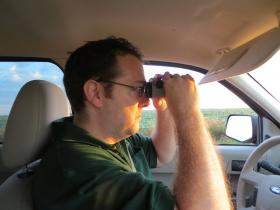 Iowa DNR Biometrician (statistician) Chris Jennelle scouts for game birds and small animals during the annual Roadside Survey