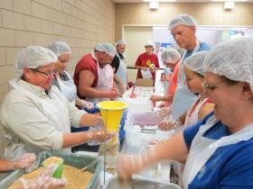 1,500 volunteers prepare 250,000 meals in 11 hours at the Varied Industries Building.