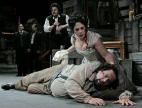"Tosca (Sondra Radvanovsky)  and Cavaradossi (Marco Berti) in the LA Opera's ""Tosca."""