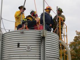 NECAS Director Dan Neenan trains firefighters at a school held at Kirkwood Community College
