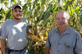 James and his father, Tom Frantzen (right), stand by their organic corn on their farm in northeast Iowa near New Hampton.