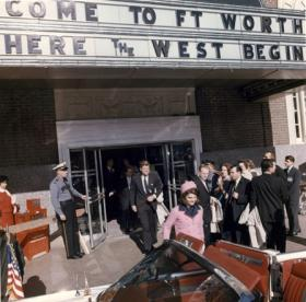 President John F. Kennedy and First Lady Jacqueline Kennedy exit the Hotel Texas after the Fort Worth Chamber of Commerce Breakfast, Fort Worth, Texas, 22 November 1963