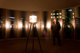 """Des Moines Art Center director Jeff Fleming stands inside of Olafur Eliasson's sculpture """"panoramic awareness pavilion"""".  This work was created specifically for the Pappajohn Sculpture Park."""