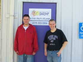 Owners John Gielau and Matt Weichers stand in front of Iowa's newest shrimp farm in Cedar Falls
