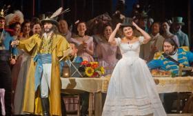 "Erwin Schrott as Dulcamara and Anna Netrebko as Adina in Donizetti's ""L'Elisir d'Amore"" at the Met"
