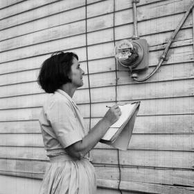 Mrs. Nolan Freeman of Albertville, Alabama takes her home's monthly electric meter reading, in October 1965. The electricity is provided by the Marshall-Dekalb Electrical Co-Op.