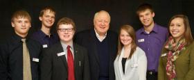 Former Sen. John Culver (center) with students at Simpson College.