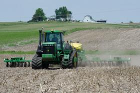 Farmers are working around the clock to take advantage of dry weather to plant their corn