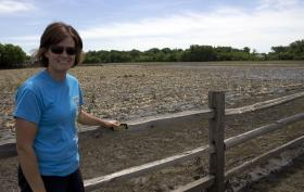 Dawn De Wit, of Rock Valley, stands beside a flooded farm field on the outskirts of this town of more than 3,000 residents in northwest Iowa.