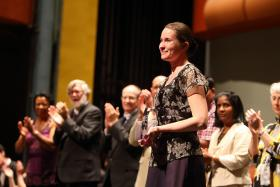 First place winner Margaryta Golovko smiles to the audience after accepting her award in the inaugural Midwest International Piano Competition.
