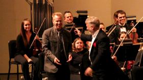 """Composer Steve Heitzeg with Maestro Joseph Giunta after the Des Moines Symphony premiers Heitzeg's work """"Symphony In Sculpture"""". The Des Moines Symphony has commissioned Heitzeg to compose a sequel to that work this season."""