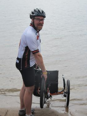Andrew Duarte dipping his bike in the river at RAGBRAI