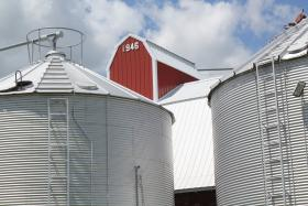 An historic granary is the oldest structure on Riley Lewis' farm, nestled today amid modern grain storage bins.