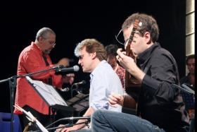 "Conductor Massimo Felici, narrator David Knopfler, and guitarist Lorenzo Micheli performing ""Morning in Iowa"" (from http://www.lorenzomicheli.com/category/photo/)"