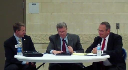 John Archer (left), University of Iowa Political Science Professor Tim Hagle (center) and Dan Dolan at a recent debate.