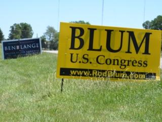 Yard signs for both Rod Blum and Ben Lange are common sights in the new first district