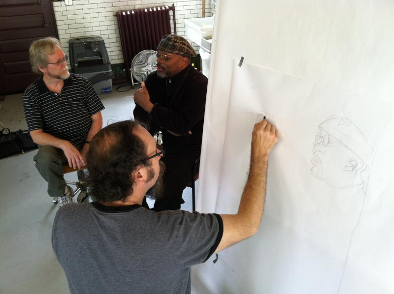 Tom Torluemke drawing Michael Petersen and Craigh Taylor.
