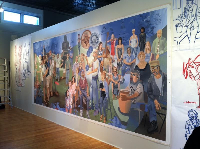 "Tom Torluemke's mural ""You Know, we're all in this Together"" is in a gallery at the CSPS building."