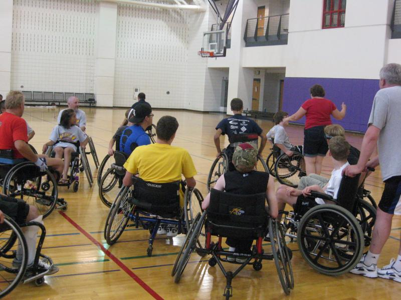 Wheelchair athletes prepare for a game of Sharks and Minnows